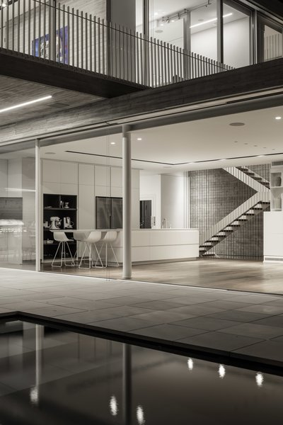 The construction technology allows the usage of big openings, a wide open floor plan and the hovering of the upper mass into the open view.   Photo 11 of The Dual House modern home