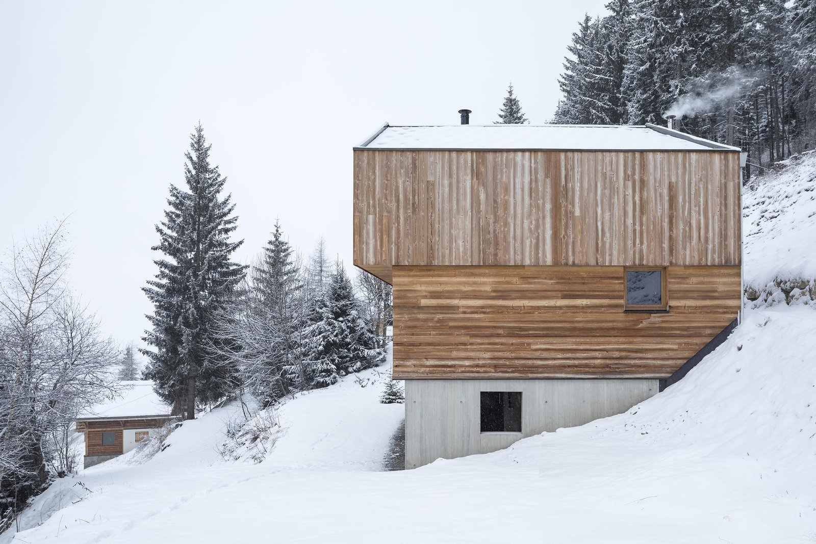 Tagged: Slope, Woodland, Trees, Exterior, House, and Wood Siding Material.  Mountain House by studio razavi architecture