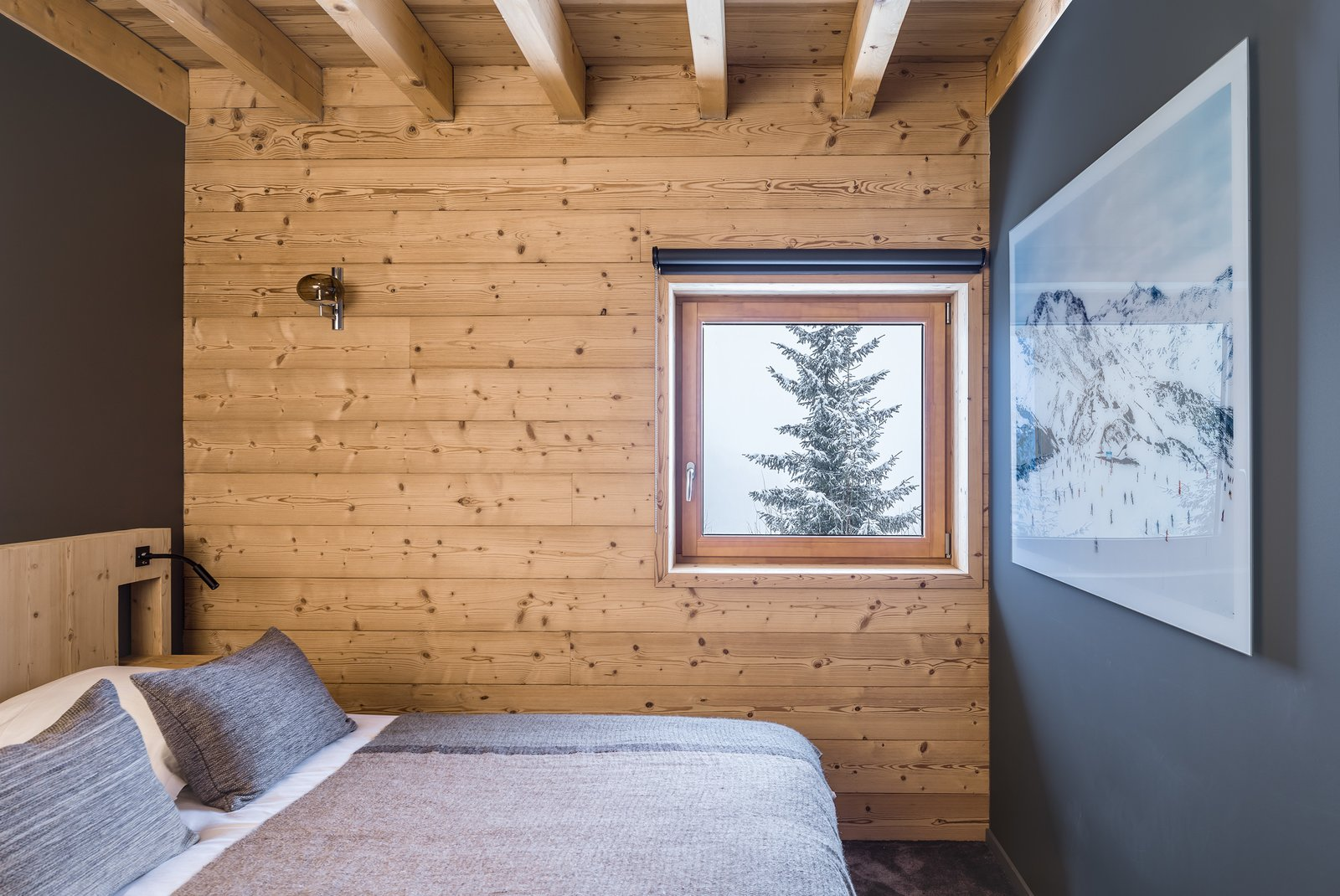 Tagged: Bedroom, Bed, Wall Lighting, and Carpet Floor.  Mountain House by studio razavi architecture