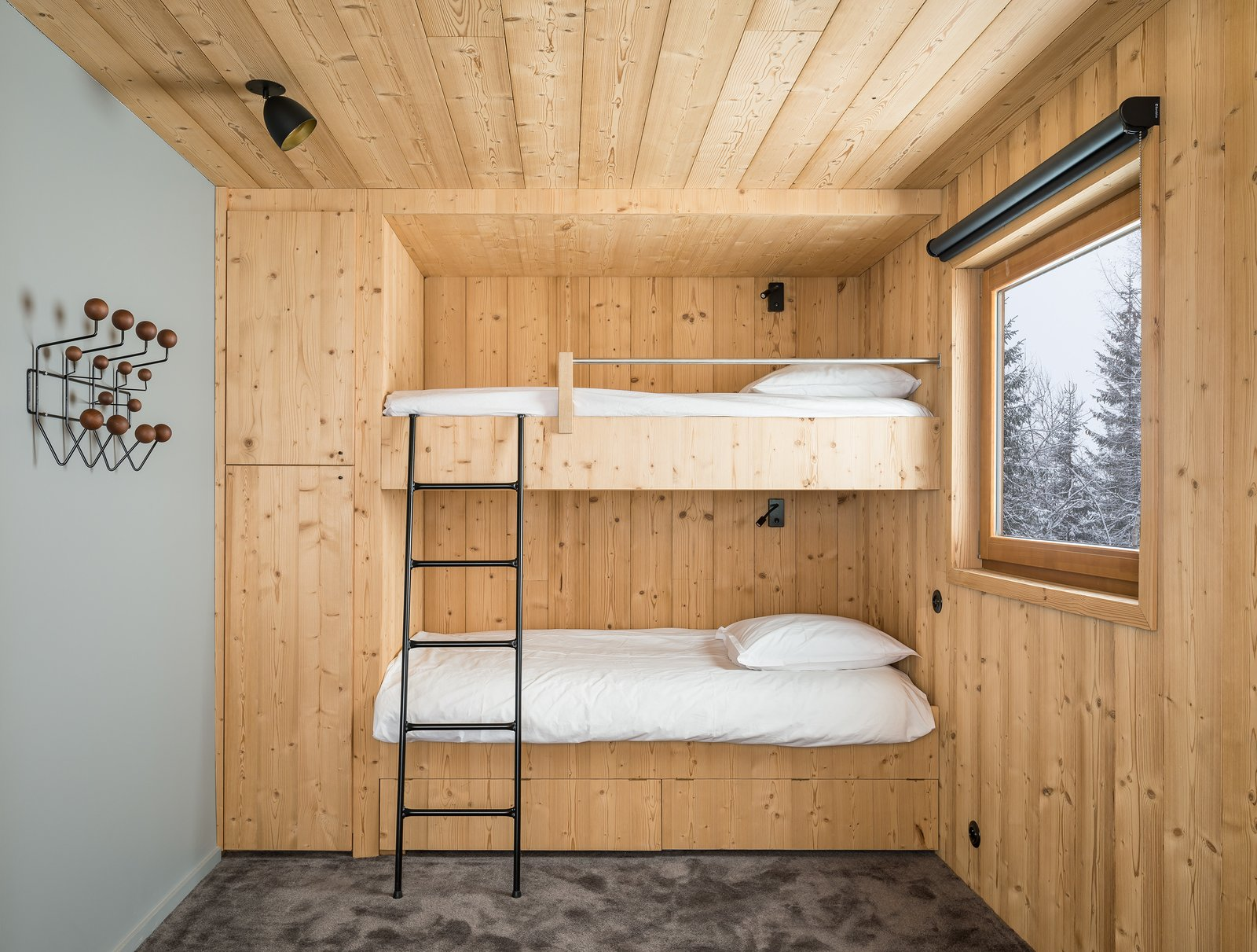 Tagged: Bedroom, Bunks, Ceiling Lighting, Wardrobe, and Carpet Floor. Mountain House by studio razavi architecture