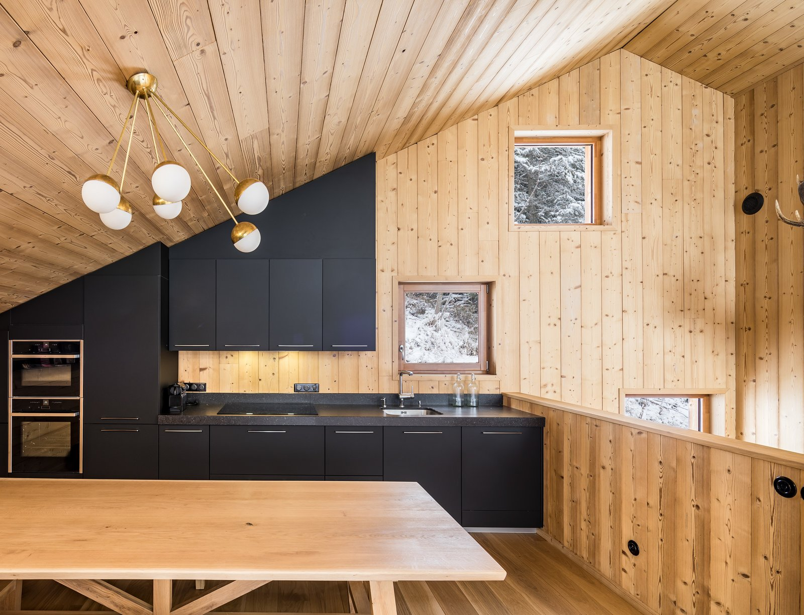 Tagged: Kitchen, Laminate Cabinet, Ceiling Lighting, Microwave, Light Hardwood Floor, Granite Counter, Cooktops, and Wall Oven. Mountain House by studio razavi architecture