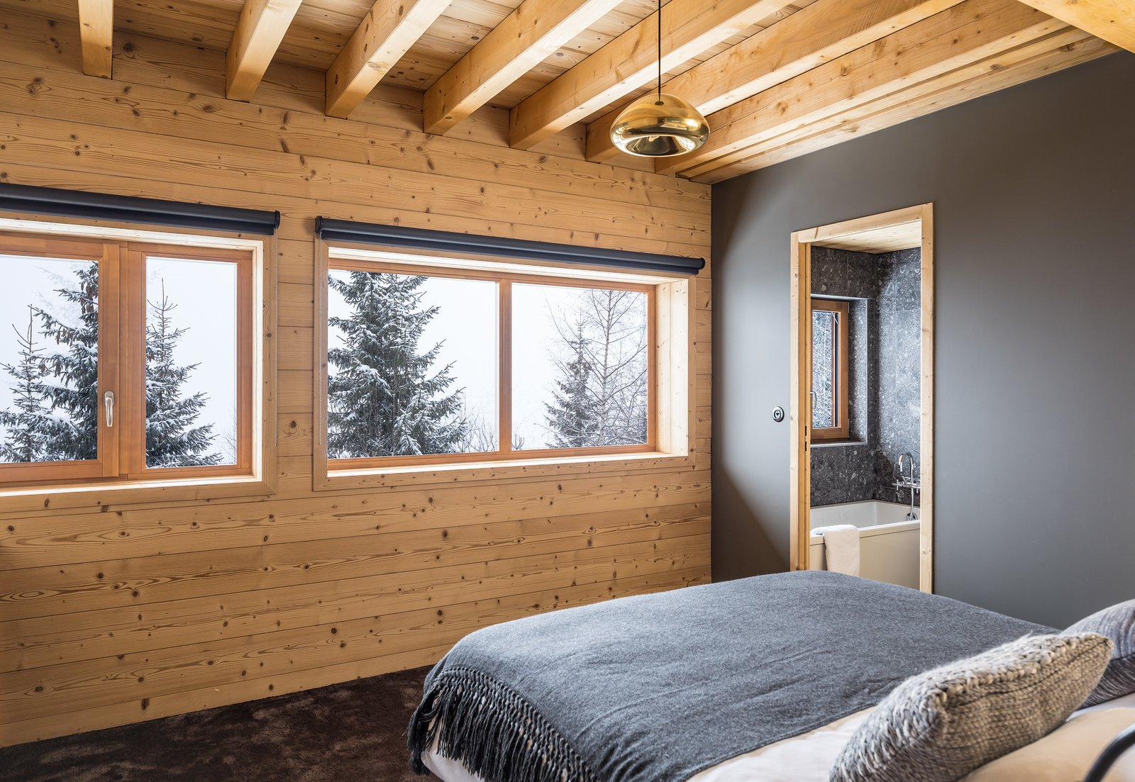 Tagged: Bedroom, Bed, Ceiling Lighting, and Carpet Floor.  Mountain House by studio razavi architecture