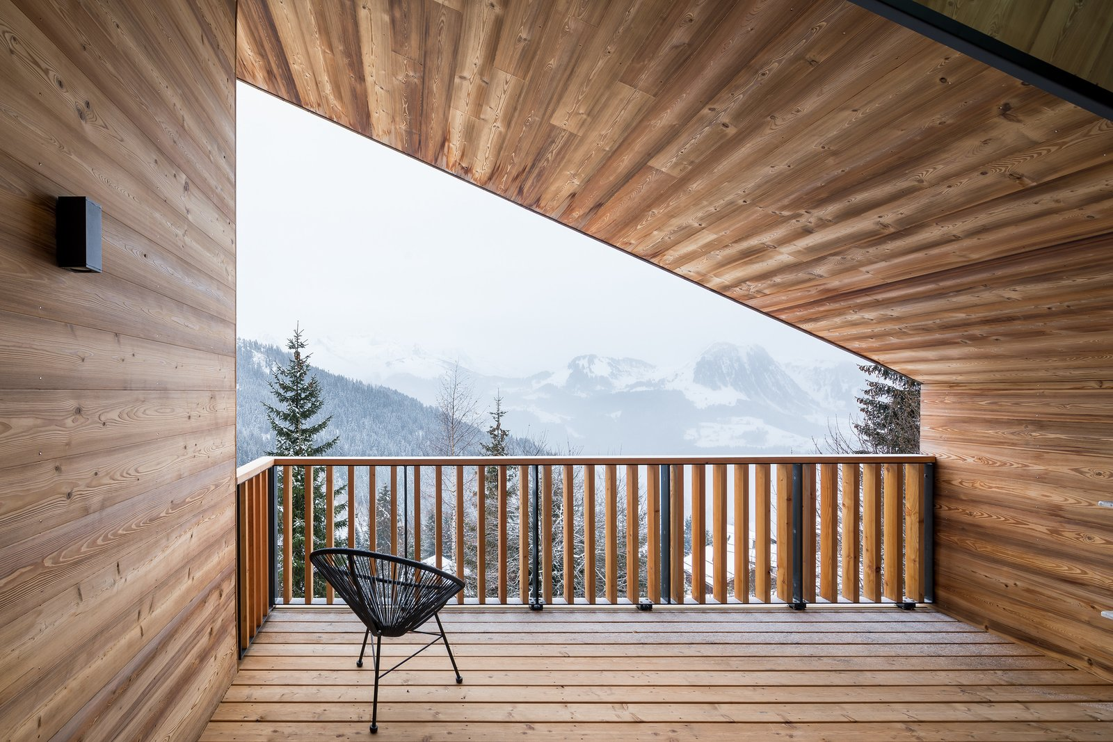 Tagged: Outdoor, Rooftop, Trees, Wood Patio, Porch, Deck, Decking Patio, Porch, Deck, Wood Fences, Wall, and Vertical Fences, Wall.  Mountain House by studio razavi architecture