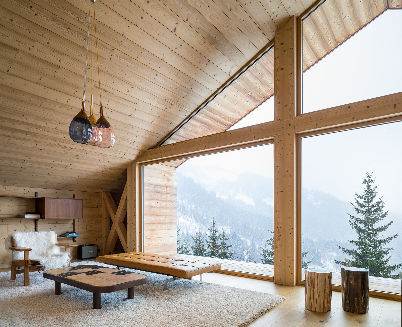 Tagged: Living Room, Coffee Tables, Ceiling Lighting, Ottomans, Light Hardwood Floor, and Console Tables.  Mountain House by studio razavi architecture
