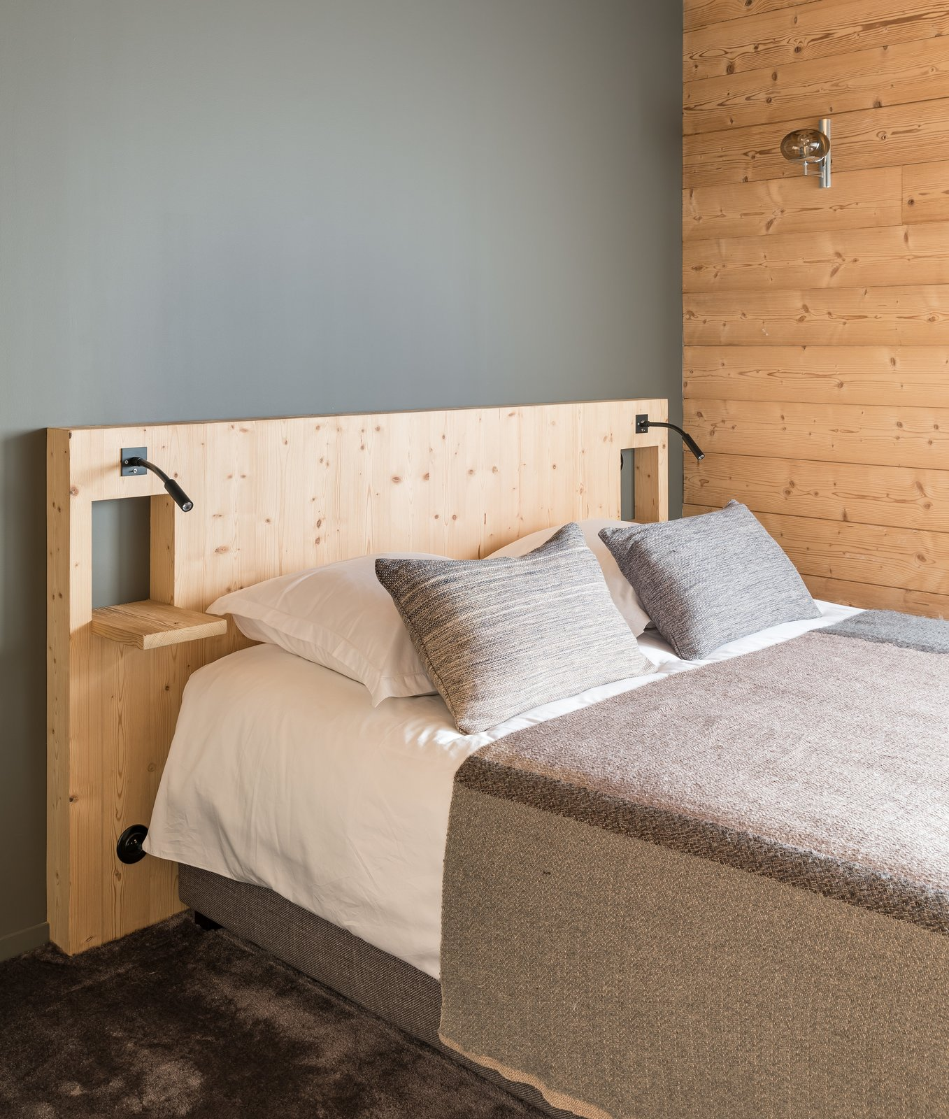 Tagged: Bedroom, Wall Lighting, Bed, and Carpet Floor.  Mountain House by studio razavi architecture