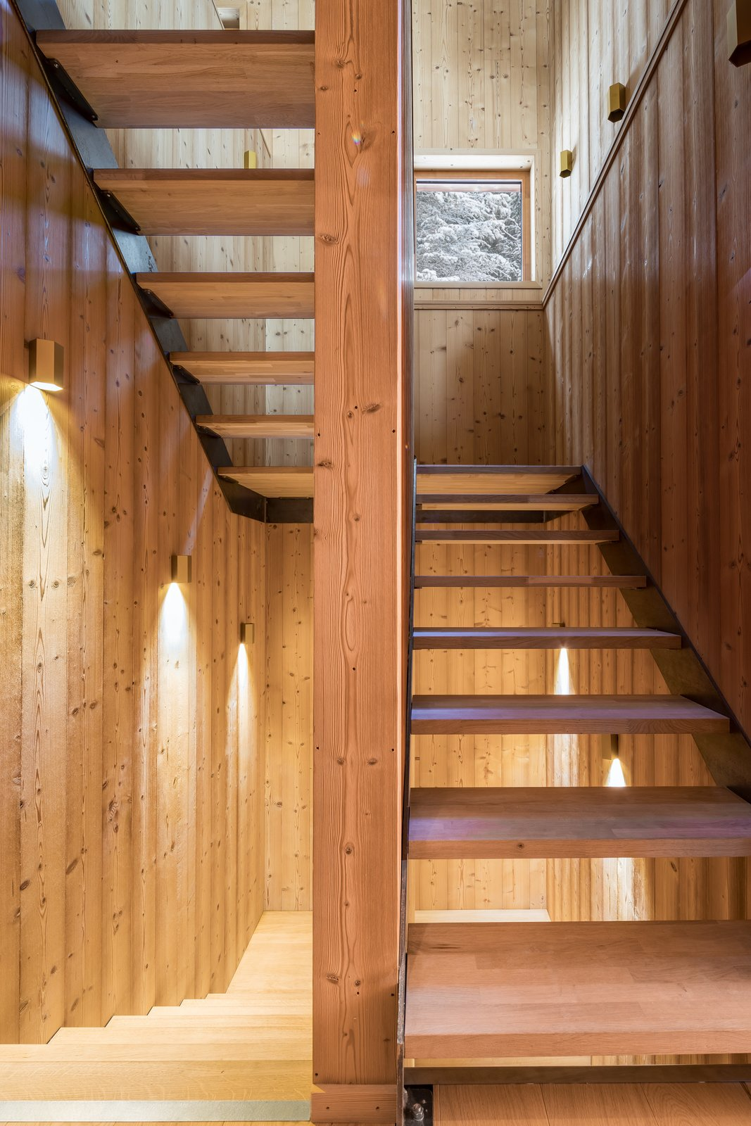 Tagged: Staircase, Wood Tread, and Wood Railing.  Mountain House by studio razavi architecture
