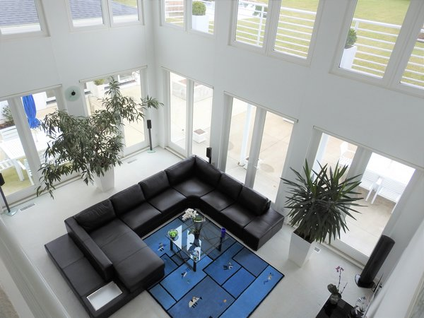Two story high living room,  surrounded by walls of windows (Marvin windows) to allow a lot of light and views to the garden and pond. Photo 2 of Modern Mediterranean modern home