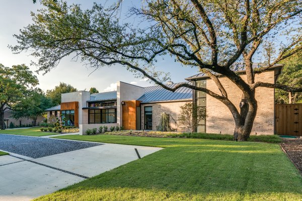Front elevation showcasing rusty metal accents Photo  of Industrial Modern Home built by husband and wife team modern home