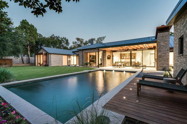 Exterior twilight photo of back patio and pool area Photo 2 of Industrial Modern Home built by husband and wife team modern home