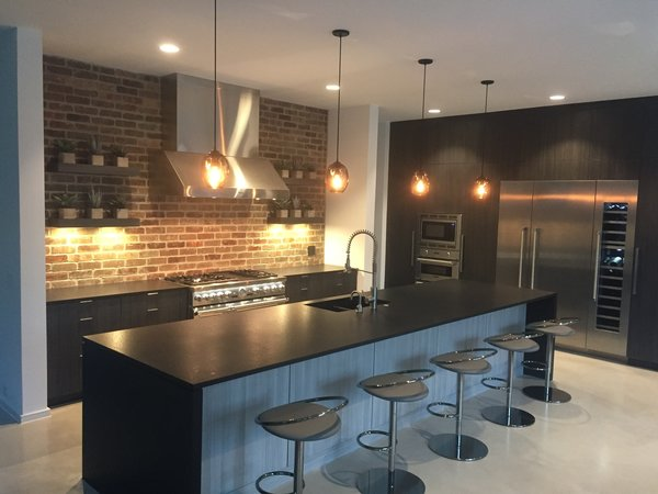 Modern industrial kitchen with Thermador appliances, Stevenswood cabinets and black leathered granite countertops. Photo 3 of Industrial Modern Home built by husband and wife team modern home