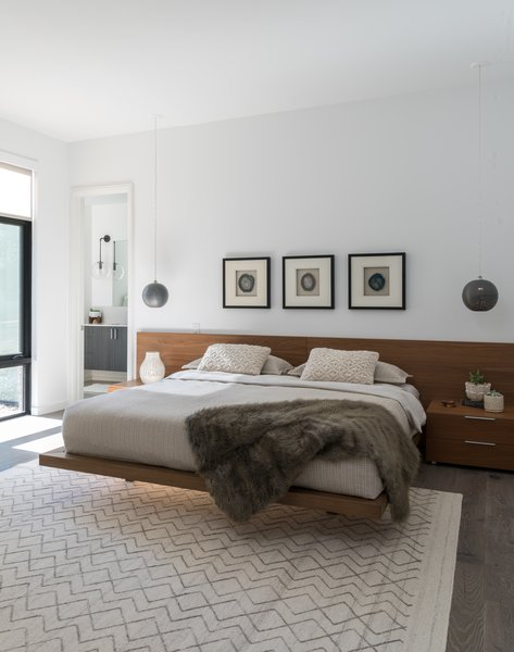 Generous use of walnut throughout the home. Photo 4 of Industrial Modern Home built by husband and wife team modern home