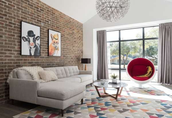 Colorful playroom with a mid century feel.  Photo 6 of Industrial Modern Home built by husband and wife team modern home