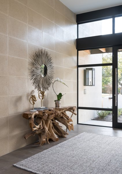 Entry with root buffet imported from Indonesia.  Western window and door. Photo 8 of Industrial Modern Home built by husband and wife team modern home