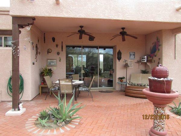 Backyard with huge brick patio  Photo 3 of Caliente Creek Ranch modern home