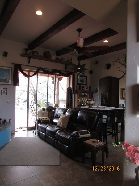 Living room area looking out thru disappearing door Photo 5 of Caliente Creek Ranch modern home