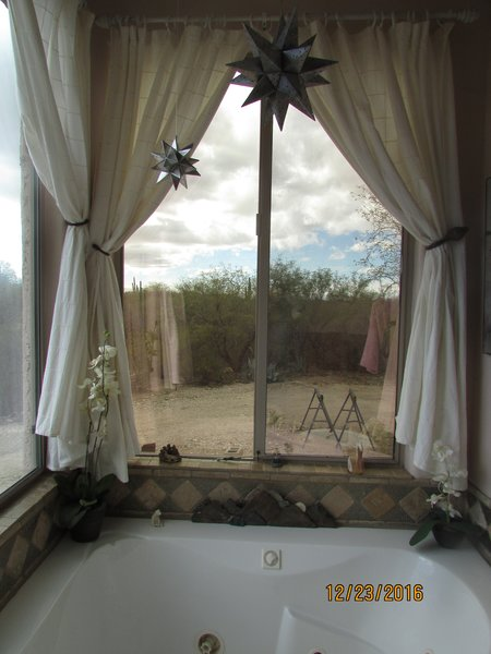 Relaxing hot tub in master bath looking out at the desert Photo 7 of Caliente Creek Ranch modern home