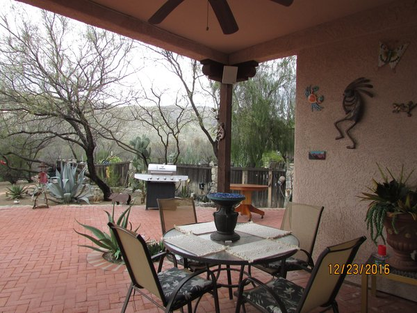 Enjoy dining out in your outside dining room  Photo 12 of Caliente Creek Ranch modern home