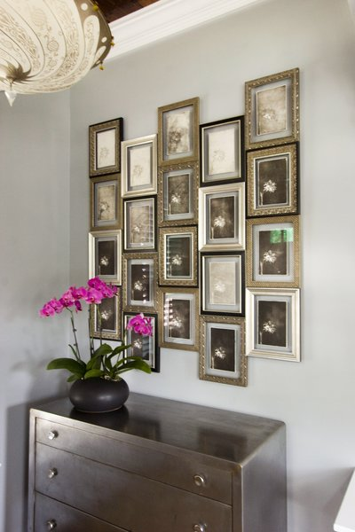 Updated front entry, custom framing of family artwork  Photo 5 of Historic Bungalow modern home