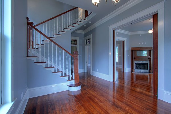 Restored grand staircase with 4 distinct historic newel posts Photo 8 of Victorian Restoration modern home