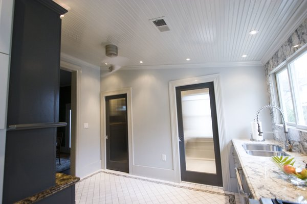 Kitchen - Entrance to powder room and laundry room. Photo 7 of Modern Victorian Interior modern home