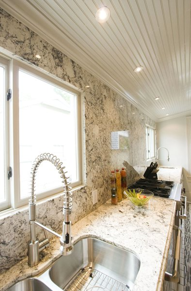 New kitchen sinks ad a wall of granite.  Photo 11 of Modern Victorian Interior modern home