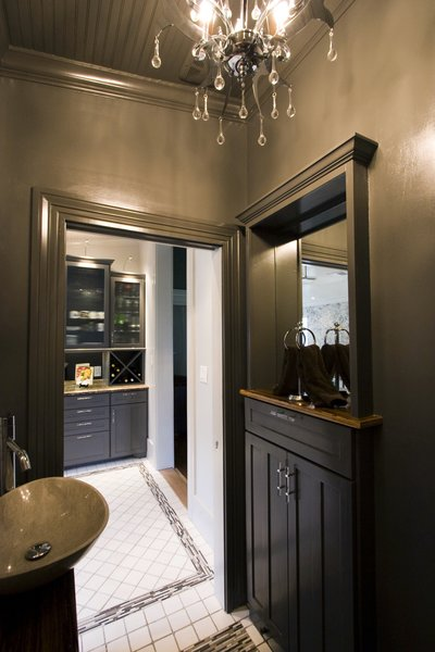 Additional Storage - The old door to the powder room was moved to the remodeled kitchen - and the old doorway was utilized to add additional storage to the Powder room without impinging on floor space in the 4 x 6 space. Photo 20 of Modern Victorian Interior modern home