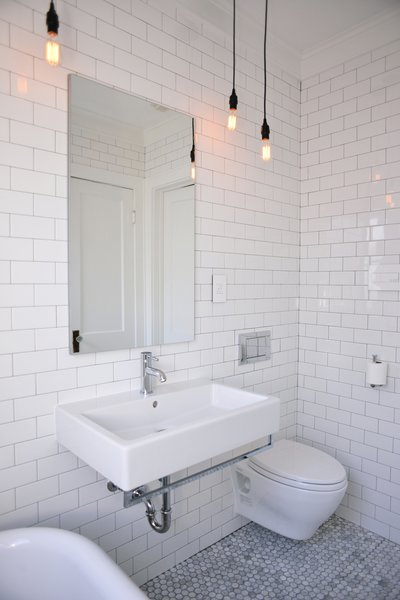 Unique fixtures, wall hung toilet and a modern Robern mirror maximized space in this small bathroom. Photo 3 of Modern Historic Bath modern home