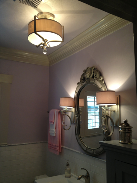 An existing mirror and new lights flow smoothly in the updated bathroom. Photo  of Forever Home - Family Bath modern home