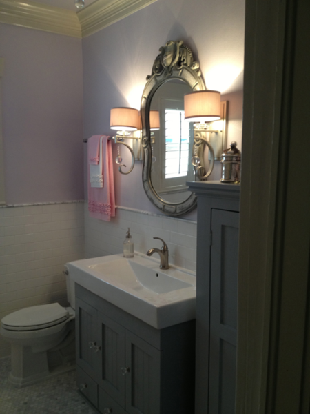 Two existing cabinets from the bathroom were modified and reused to give this bathroom the charm the homeowner was looking for.  Paint colors were chosen based on the future users of the bathroom. Photo 2 of Forever Home - Family Bath modern home