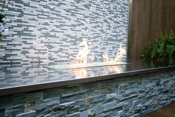 The fireplace shined and added some necessary heat in the winter months. Photo 4 of Outdoor Living modern home