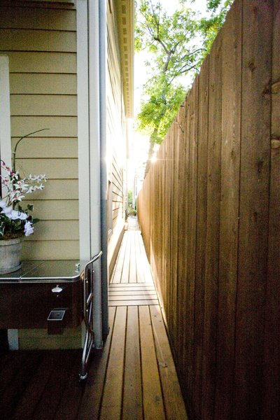 A side entrance was created so that when entertaining, guests could proceed directly to the backyard. Previously, this was dirt filled area that had little use. Photo 12 of Outdoor Living modern home