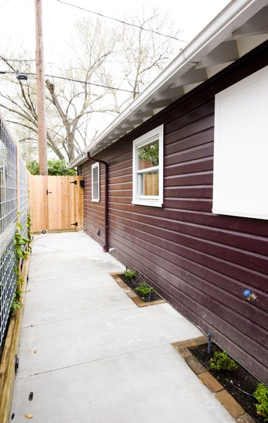 A new patio was built for more exterior space for the homeowner and their renters.  Hardscaping and landscaping were installed with an eye towards maintenance. Photo 4 of Asian Bungalow modern home