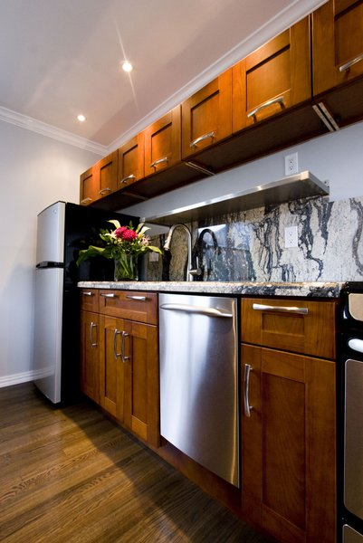 An updated kitchen with plenty of storage and high end finishes set this apartment apart from the competition. Photo 2 of Asian Bungalow - Garden Apartment modern home