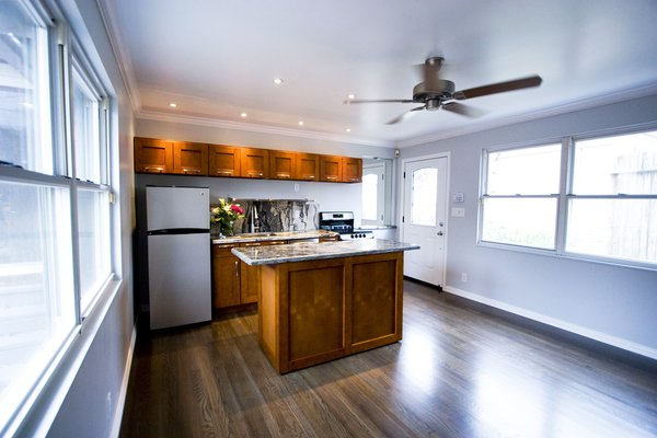 The cabinets allowed for lots of storage and the movable island allowed for any number of configurations in this small space. Photo 6 of Asian Bungalow - Garden Apartment modern home