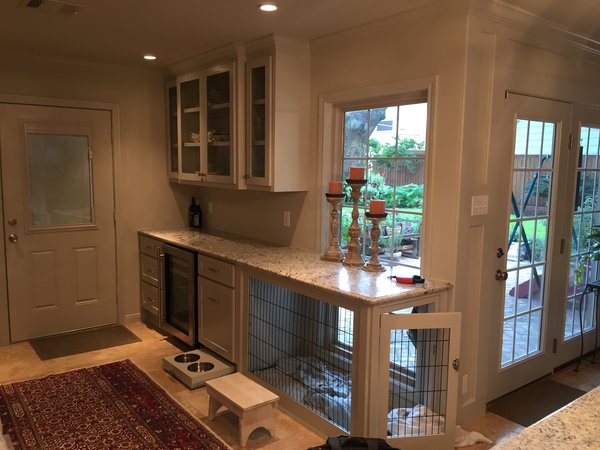 A beverage center, display case and a custom dog bed (including pull-out food bowls for the dogs) made a previously unusual space a favorite of the families. Photo 5 of ADA Kitchen modern home