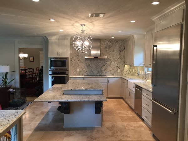The new space - formerly divided by a wall between the kitchen and the family room - became a much needed focal point for the family. Photo 2 of ADA Kitchen modern home