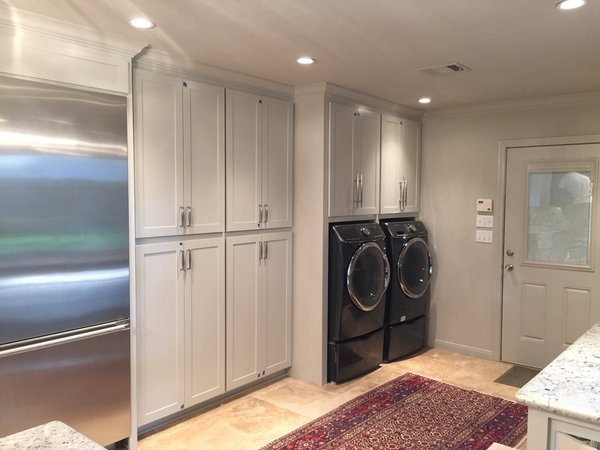 The former laundry room was opened up to the kitchen and allowed for a large pantry and laundry area.  The washer and dryer were built into the cabinets with doors that recessed into the sides of the cabinets and allowed them to be hidden away when guests were over. Photo 6 of ADA Kitchen modern home