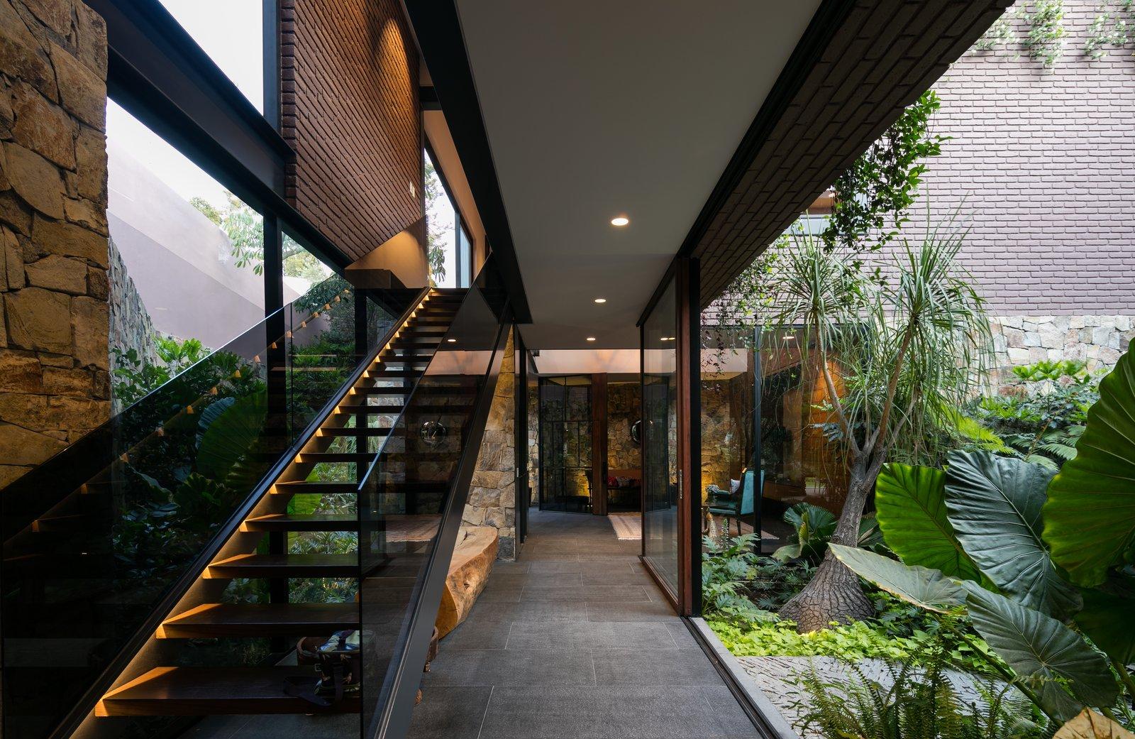 Tagged: Staircase, Metal Tread, Wood Tread, Glass Railing, and Metal Railing.  Casa OM1 by Santiago Rivero