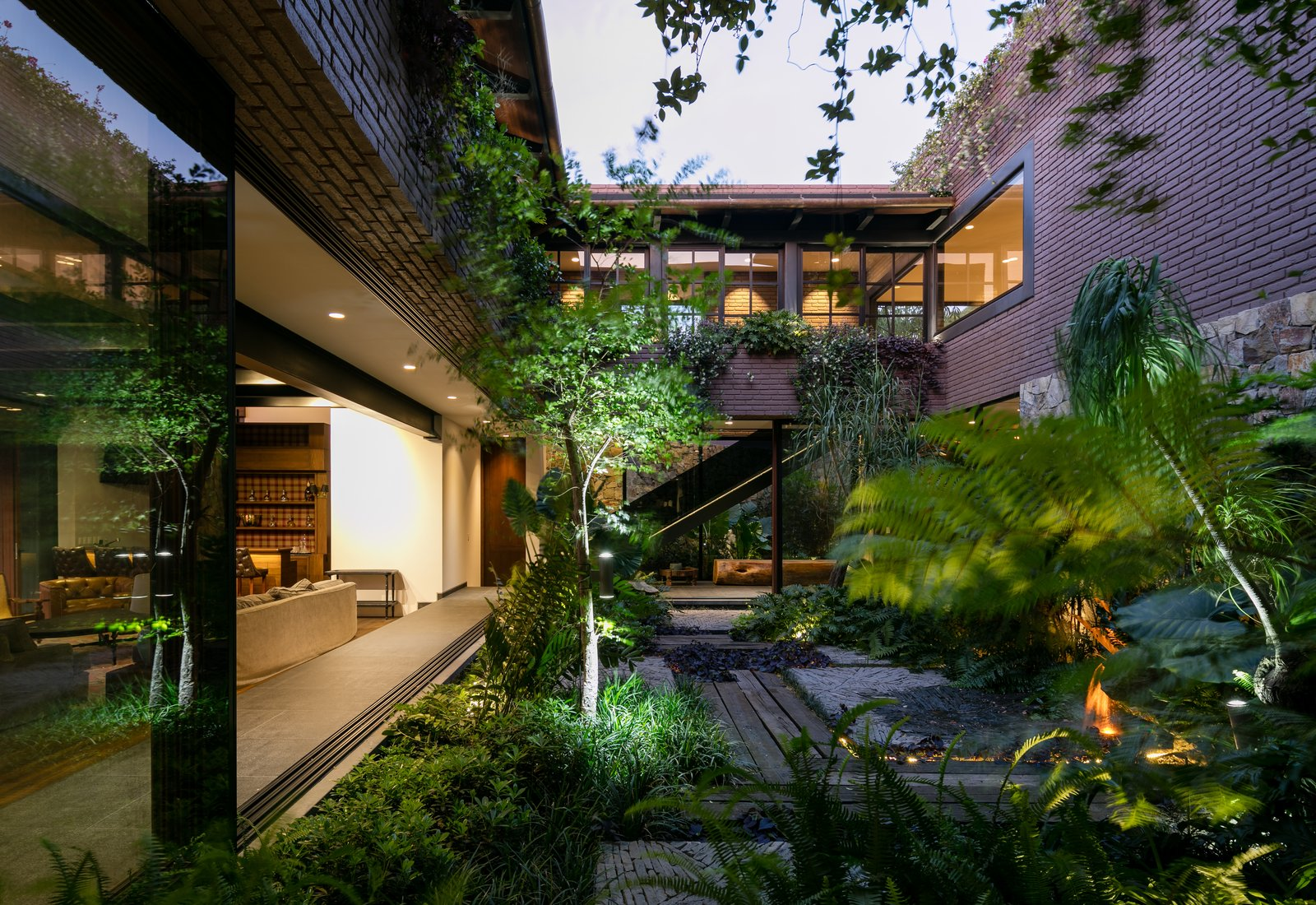 Tagged: Outdoor, Trees, Walkways, Gardens, Decking Patio, Porch, Deck, Side Yard, and Garden.  Casa OM1 by Santiago Rivero