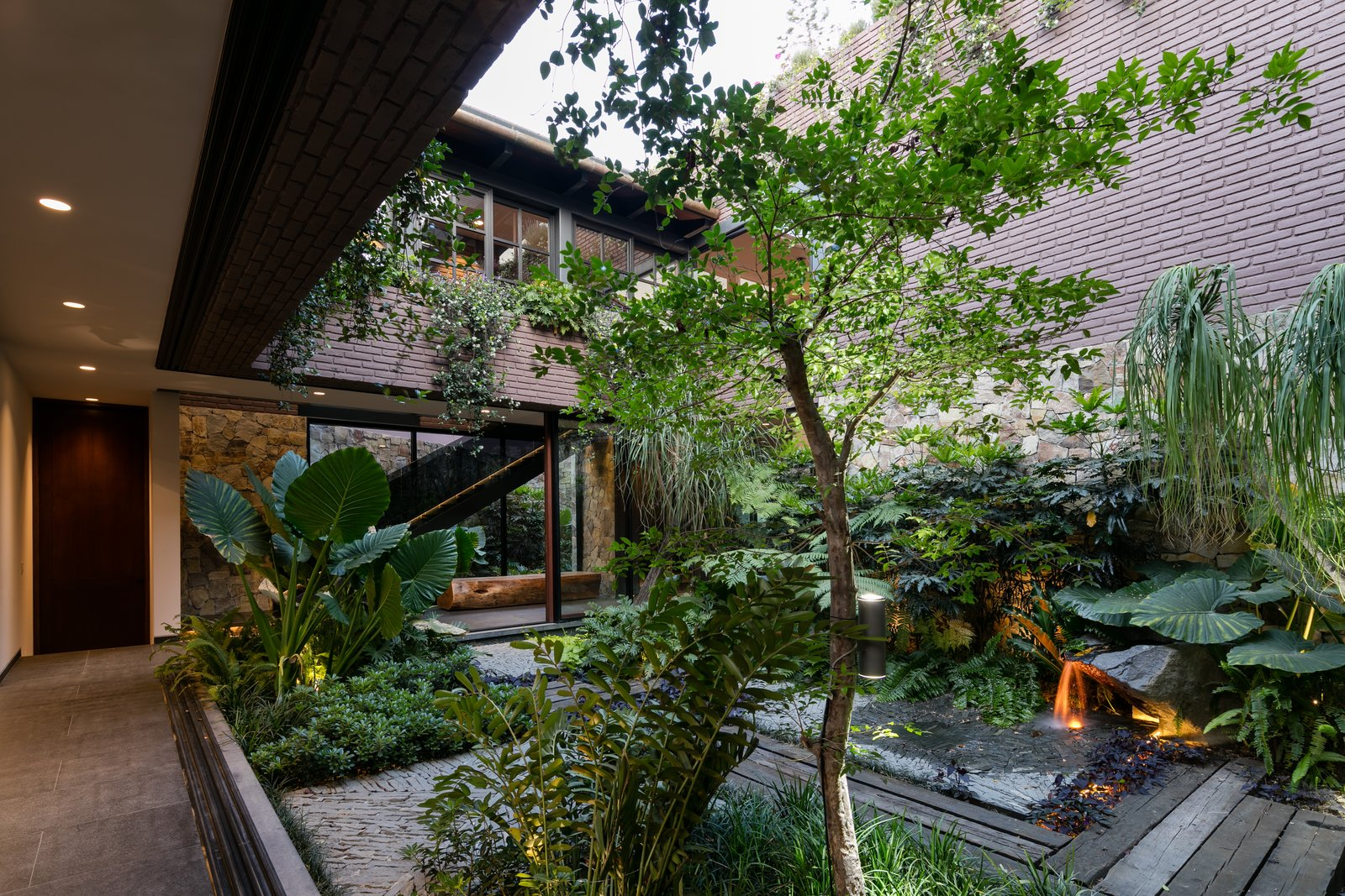 Tagged: Flowers, Shrubs, Grass, Trees, Garden, Standard Construction Pools, Tubs, Shower, Landscape Lighting, Metal Fences, Wall, and Wood Fences, Wall.  Casa OM1 by Santiago Rivero