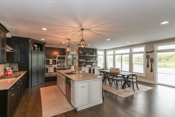 Large chef inspired kitchen with custom two tone design Photo 5 of Modified Amelia II Model by DJK Homes modern home