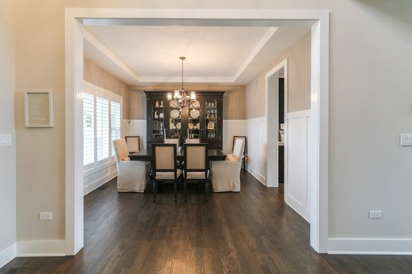 Elegant dining room with custom wainscoting and stepped ceiling detail  Photo 15 of Modified Amelia II Model by DJK Homes modern home