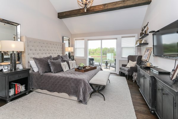 Master bedroom with high vaulted ceilings with exposed wood beams and private balcony Photo 20 of Modified Amelia II Model by DJK Homes modern home