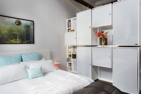 Bedroom with backside of paneled wall that also serves as a closet Photo 13 of J Schatz Studio and Home in Providence modern home