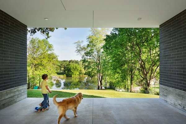 The carport frames a wonderful view of the river beyond and provides a sheltered play area during rain or excessive heat Photo 15 of Boetger Residence modern home