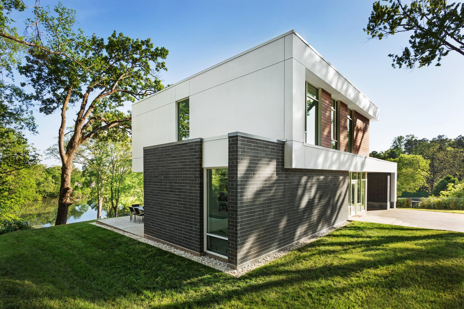 The home protects the patio from afternoon heat and sun  Boetger Residence by Chad Boetger