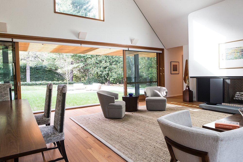 Living Room and Dining Room with lift and slide door open to yard  Gable House by Michael Goorevich