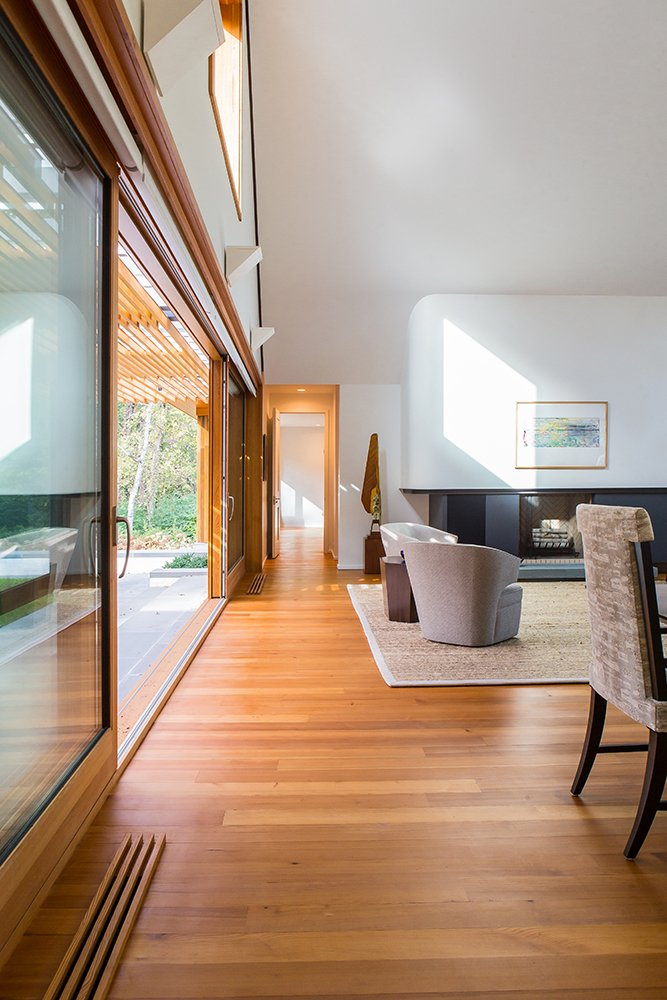 Living Room with lift and slide door and fireplace beyond  Gable House by Michael Goorevich