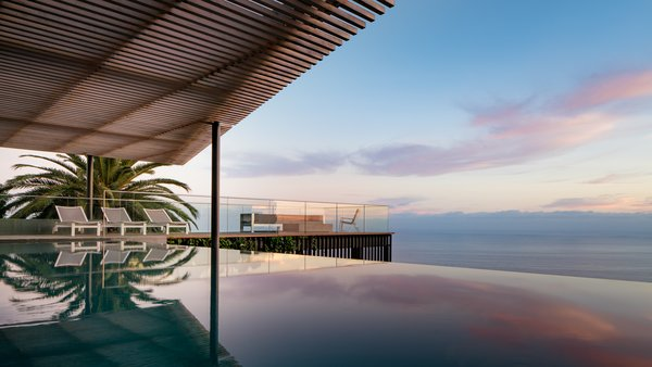 Modern home with outdoor, slope, back yard, garden, gardens, swimming pool, large pool, infinity pool, small patio, porch, deck, large patio, porch, deck, small pool, wood patio, porch, deck, decking patio, porch, deck, and metal patio, porch, deck. South facing arbor with pool at sunset Photo  of Malibu Hillside