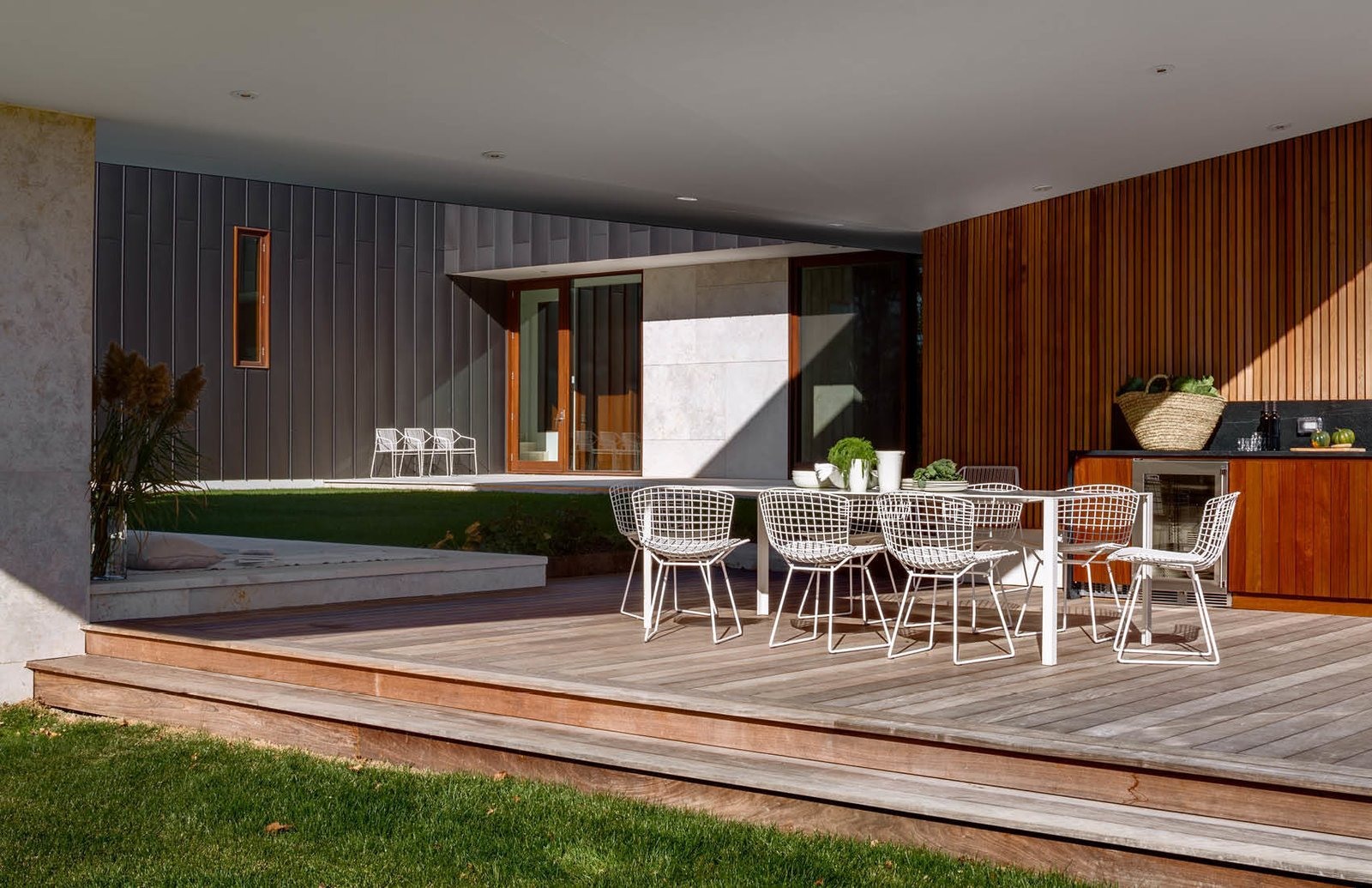 Pool Patio sits under the cover of the cantilevered family wing above